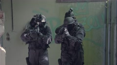 A Special Force Team walk through a open corridor. Stock Footage