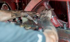 Grease and oil hands of the machine engineer of steam locomotive 46.03 of Bul Stock Photos