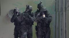 A Special Force Team walk through a open corridor. Stock Footage