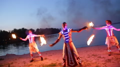 Fireshow performance with burning torch near river in evening Stock Footage