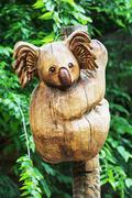 Wooden statue of cute koala, artistic object - stock photo