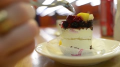 Man eating cake with spoon at the mall cafe - close shot Stock Footage