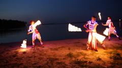 Group of people show fire performance at night outdoor Stock Footage