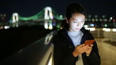 Woman using mobile phone at Tokyo city Stock Footage
