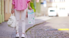 Closeup backpack and map in female hands background european the city Stock Footage
