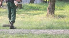 Gardener Mows the Lawn Mower Green Grass Stock Footage