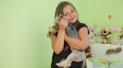 Little girl is hugging her dog - stock footage