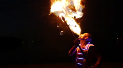 Fire show artist breathe fire in the dark Stock Footage