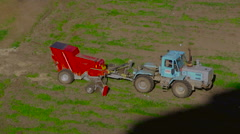 Tractor At Work. birds are flying behind the tractor. Aerial view Stock Footage