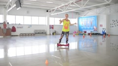 Girl dancing balancing Segway Hoverboard scooter Stock Footage