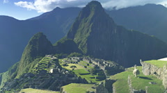 Llamas sitting on a terrace at machu picchu Stock Footage
