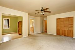 Old craftsman style house with beige interior paint. Carpet floor and built-i - stock photo