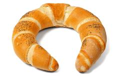 Baked crescent on white Stock Photos