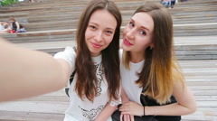 Beautiful happy girls smile and making selfie. Young tourist friends traveling Stock Footage