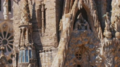 The facade of the famous Sagrada Familia, elements of decoration, sculptures Stock Footage