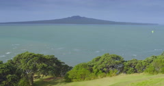Aerial of Kitesurfers surfing in front of rangitoto island Auckland New Zealand - stock footage