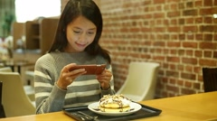 Woman taking photo on her dessert at coffee shop Stock Footage