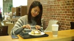 Woman having cake at coffee shop Stock Footage