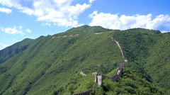 The majestic Great Wall of China, mountains inscribed loyal to Chairman Mao Stock Footage