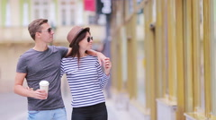 Romantic couple walking together in Europe. Happy lovers enjoying cityscape with Stock Footage