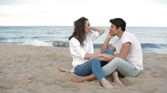 Couple in love sitting on the beach Stock Footage