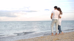 Couple in love hugging at the beach Stock Footage