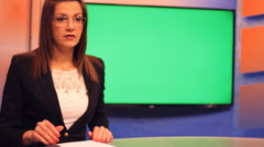 TV presenter  ,Green Screen  background ,side shot  Stock Footage