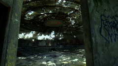 Communist monument inside a huge hall in ruins - stock footage