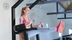 Woman trains lower abdominal muscles at the fitness centre Arkistovideo