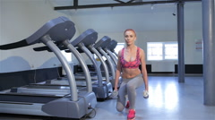 Woman does step-up exercise at the fitness centre Stock Footage