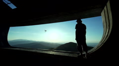 Man observed mountain landscape  through a huge window Stock Footage