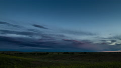 Time lapse - Thin clouds over road across the prairie at sunrise Stock Footage