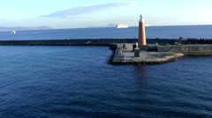 Statue of St,Januarius and Mole lighthouse at the entrance in port of Naples. Stock Footage