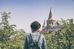 Woman overlooking the tower of the fisherman's bastion Stock Photos