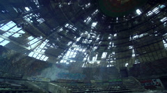 Sun rays penetrate through the roof of a huge monument of communism Stock Footage