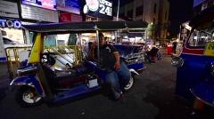 Speeding auto rickshaw on Khao San road street in Bangkok Stock Footage