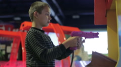 A boy playing a game on the game simulator Stock Footage