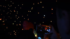 Fire Lanterns. Crowd of People Shooting With Smartphone Stock Footage
