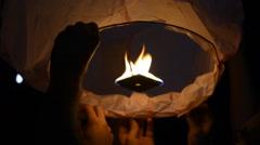Fire Lantern. People Launching Traditional Chinese Lantern Stock Footage