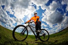 Cyclist on the Beautiful Meadow Trail - stock photo