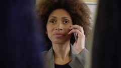 Afro American commuter on her way to work using smart phone Stock Footage