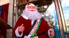A Santa Claus with the flag of Palestine in Bethlehem, the birthplace of Christ Stock Footage