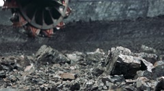 Coal with big machine for collect - close-up collecting wheel Stock Footage