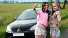 Two cute women making selfies on roadtrip - stock footage
