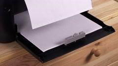 Office desktop laser printer paper feeder - stock footage