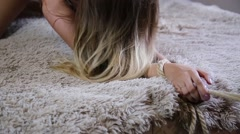 close-up hands of a young woman lying on a bad. she have sex - stock footage