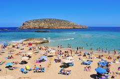 Sunbathers at Cala Conta beach in San Antonio, Ibiza Island, Spain Stock Photos