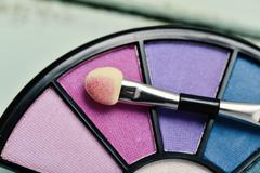 Eye shadow palette and applicator Stock Photos