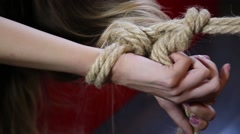 Close-up hands of a young woman lying on a bad. couple in a intimal moment Stock Footage