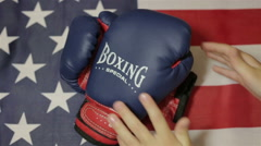 Kids boxing gloves and an American flag - stock footage